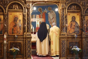 The Mass commences behind the iconostasis